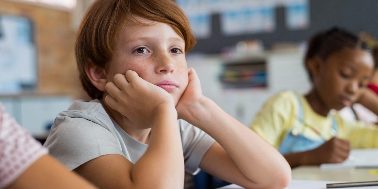 bored-school-boy-in-class-PT64EDK (1)
